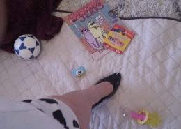 Ms. Ava's foot among adult baby items